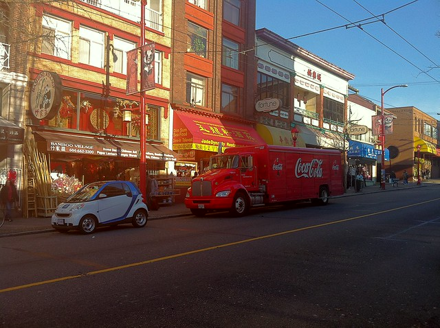 car2go and a Hybrid Coca-Cola delivery truck in Chinatown