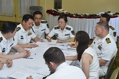 Representatives from U.S. Pacific Fleet, U.S. Pacific Air         Forces and the People's Republic of China People's Liberation Army         Navy and Air Force met May 25. (U.S. Navy/MC2 Tamara         Vaughn)
