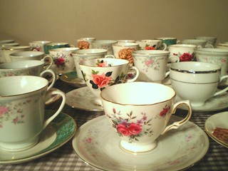 teacups and saucers on gingham cloth | by Prudence Styles