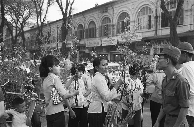 Scenes of Tet including the flower market; Saigon.