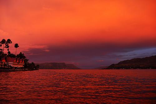 travel hotels tabocottages tourism landscape lake sky blue orange purple red rainforest jungle tropics southeastasia indonesia sumatra samosir tuktuk laketoba flickraward blinkagain dnysmphotography dnysmsmugmugcom