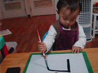 2-years-old boy  writing  flagsJapan and  Japan by kanji