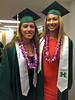 Women's volleyball senior graduates Tai Manu-Olevao, left, and Olivia Magill at the University of Hawaii at Manoa spring commencement ceremony on May 14, 2016.