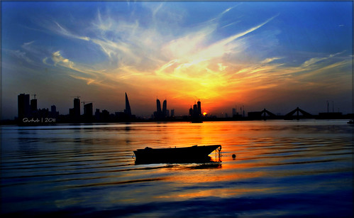 ocean blue sunset sea sky reflection water skyline clouds boat bahrain towers silhoutte arabiansea