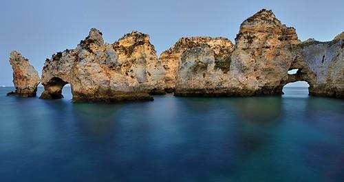 ocean sunset sea seascape beach portugal water rock coast sand nikon rocks arch natural cove rocky tunnel cliffs lagos atlantic caves coastline ponta algarve coves piedade pontadapiedade joaofigueiredo nikond3x joaoeduardofigueiredo
