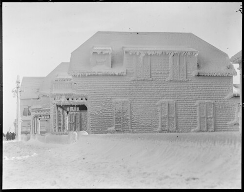 Ice-covered house during storm, Winthrop