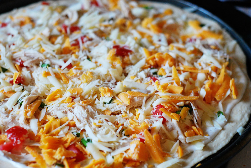Chicken Ranch Pizza - delicious homemade pizza with ranch dressing, chicken, 3 types of cheeses, fresh tomatoes, and green onions! This one is always a hit!