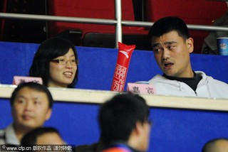 December 14th, 2011 - Yao Ming and wife Ye Li attend a Shanghai MAXXIS Sharks game | by ballclub