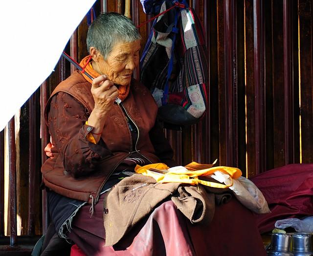 She reads in a Pecha, a Tibetan style book.