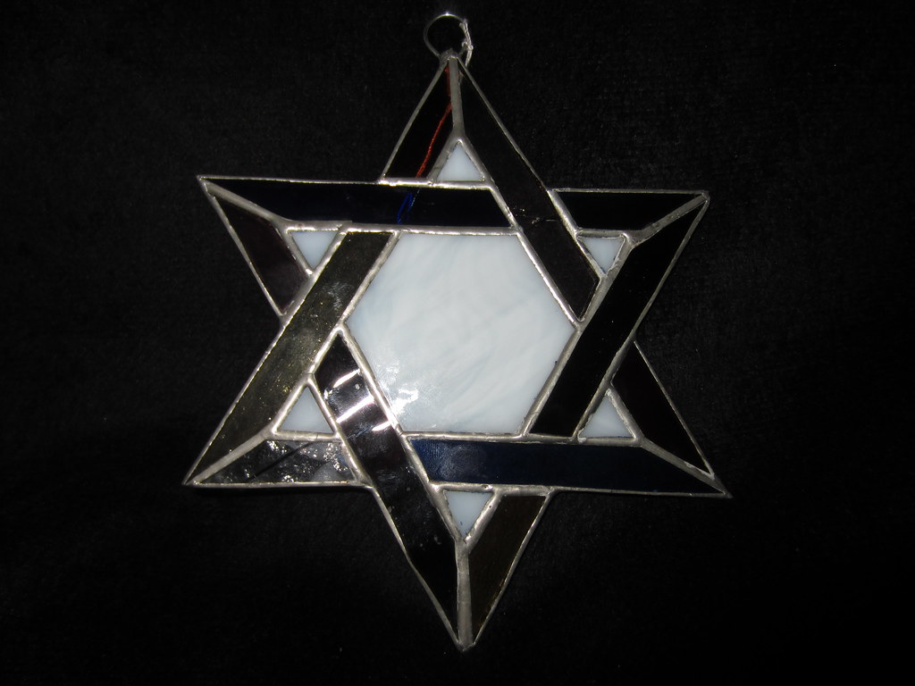 "Star of David ( Jewish Star ) made of stained glass purchsed from a store on Avenida Revolucion aka "" The Revo "" in Tijuana Mexico"