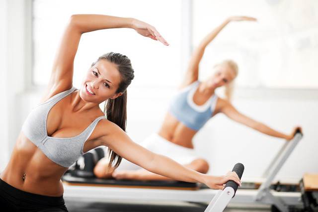 Young women doing Pilates exercises.