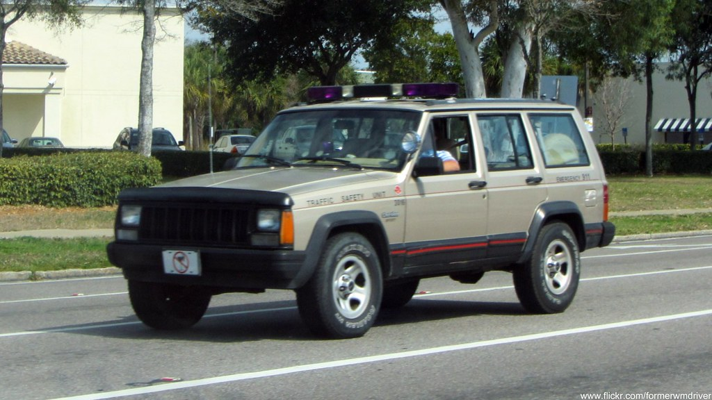 Traffic Safety Unit Jeep Cherokee With A Purple Lightbar