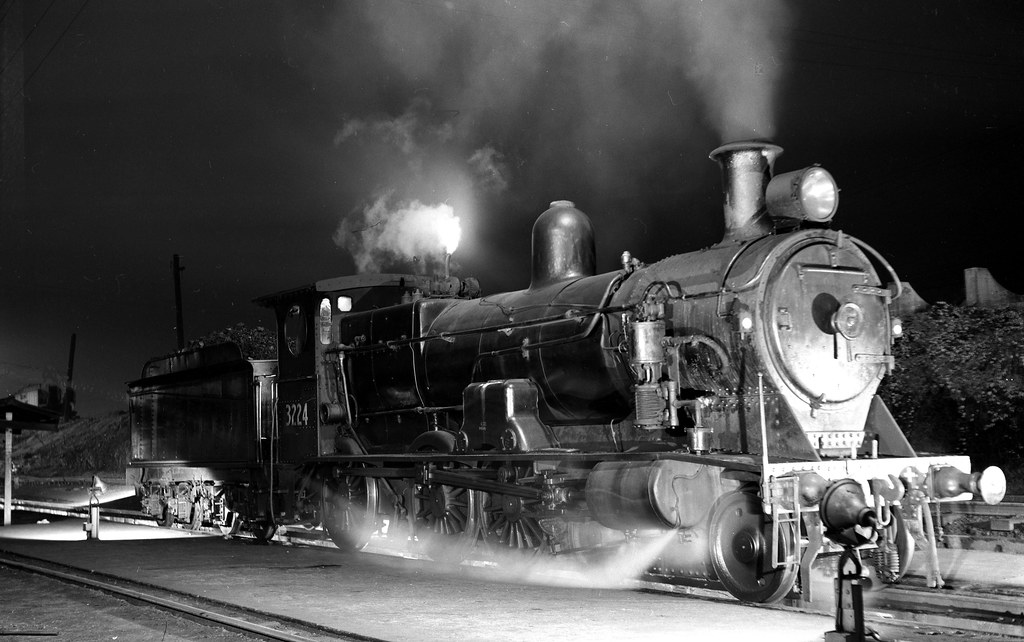 12330 (525) 16-05-1968 New South Wales Government Railways 4-6-0 steam locomotive 3224 night time at the locomotive depot at Enfield, Sydney, N,S.W., Australia by John Ward