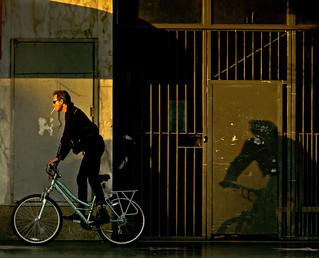 Man Riding Bicycle (with Virginia Slim?)