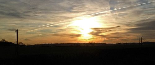 emley west yorkshire uk telegraph poles pole wire fields bright light sunrise winter cold morning silhouette vapour trails trail white sky skies cloud clouds wisps