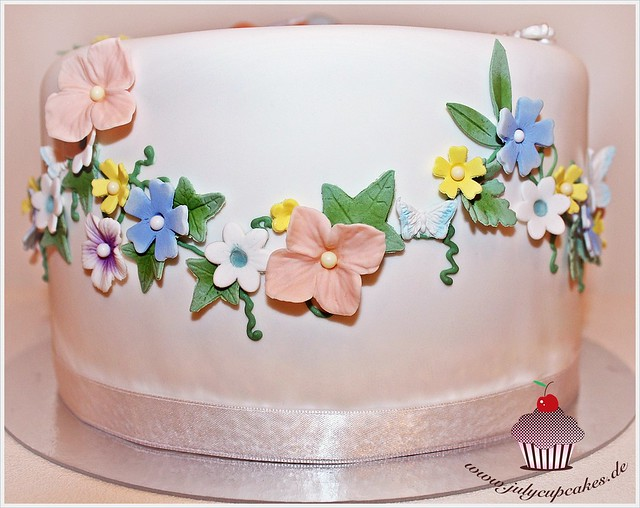 Christening Cake composed of delicate Swags of tiny sugar Flowers and Ivy Leaves