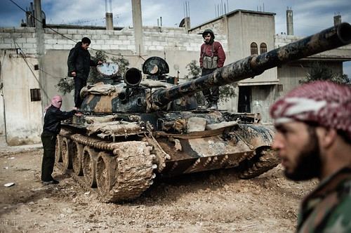 Feb. 23, 2012. A Free Syrian Army member prepares to fight with a tank whose crew defected from government forces in al-Qsair | by FreedomHouse