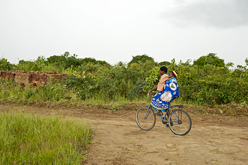 africa people woman baby black field bicycle horizontal kids rural children kid clothing community village child adult african centre traditional small transport young mother center southern malawi transportation anthony afrika cloths mid based childcare cbcc asael mzimba tonthowere