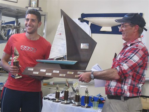 Dario Motta, winner of the RSA Regatta being presented with RSA Regatta trophy by Will Perry | by PLSC (Panmure Lagoon Sailing Club)