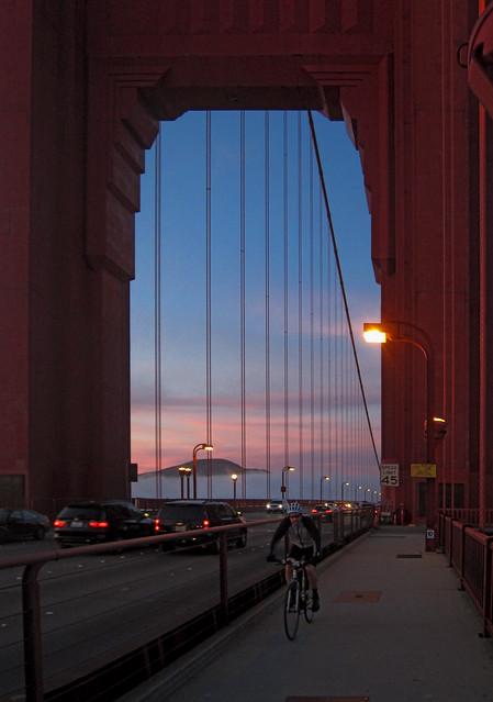 Cyclist on Golden Gate Bridge at sunset.  San Francisco (2012)