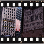 """Wed, 14/07/2010 - 11:27am - According to Jump, this image taken on 47th Street in 1997 """"best illustrates the collision of two advertising eras and serves as a time capsule."""" A friend called Jump after a building had been demolished to expose this ad. That didn't last long as one year later it was obscured again when a new building rose in the same lot. Jump notices the juxtaposition of ads in the background: one advertising Broadway shows, a spiraling red and white ad for Levi's rises above an ad for a stereo system. In the lower left corner of the image is a banner for """"Broadway Cares/Equity Fights AIDS."""" Jump said he feels it's an on-going testament to the continual renewal of New York City.   Photo by Frank Jump."""