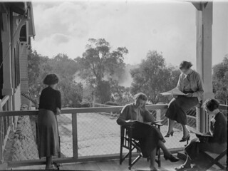 Reading on the verandah | by State Library Victoria Collections