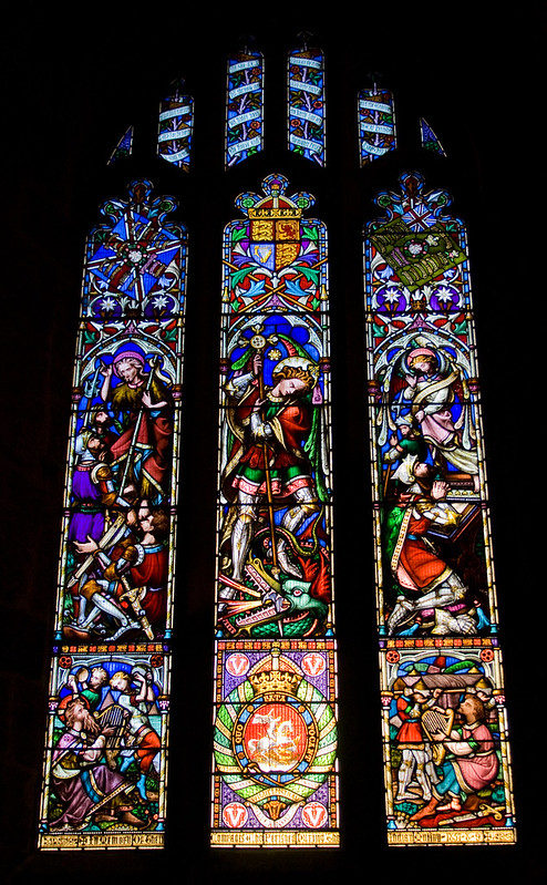 An image of a stained glass window showing St George killing the dragon from St Nicholas' Cathedral in Newcastle.