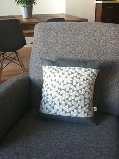 grey cushion in situ
