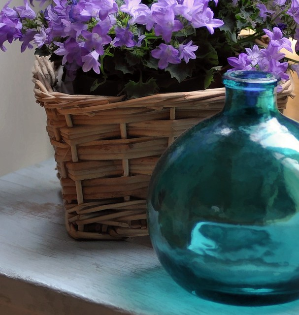 campanula and bottle on chemistry stool