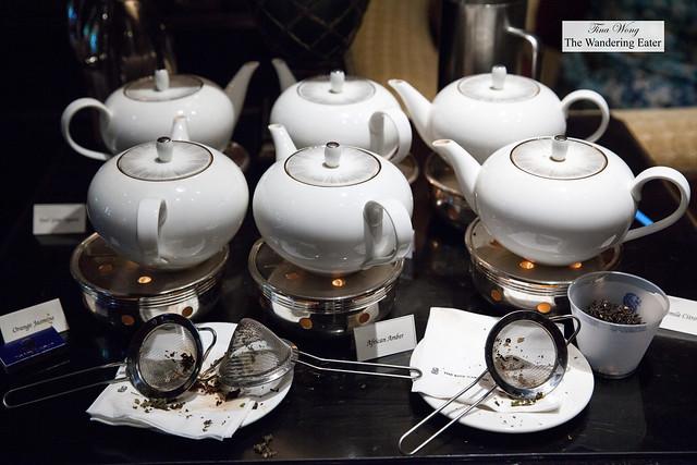 Assortment of tea pots steeping