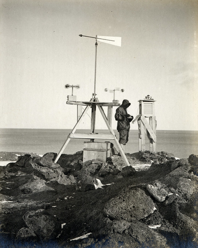Dr Simpson taking meteorological observations at the station on Vane Hill, Cape Evans