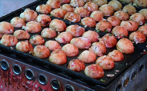 takoyaki, doughy balls filled with octopus or squid