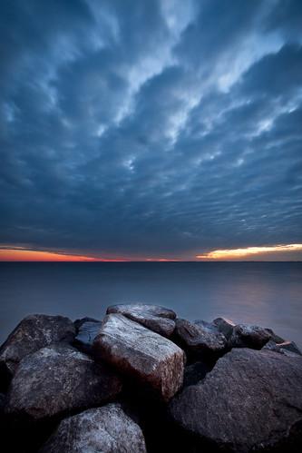 longexposure morning water clouds sunrise dawn rocks jetty rocky northbeach chesapeake chesapeakebay