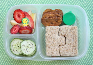 Puzzle sandwich, organic apples & strawberries, cukes, pretzels & tiny treat | by anotherlunch.com