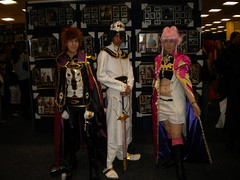 Emperor Lelouch from Code Geass R2  I think the person on his left is Suzaku and I don't know who the other is.