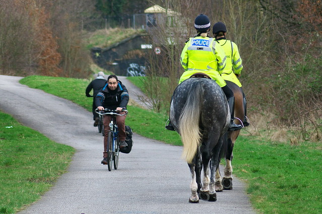 Cyclist and Mounted Policewomen