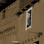 Woman in the window - Mujer en la ventana; Totora, Departamento de Cochabamba, Bolivia