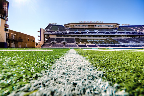 playing green sports field grass yard football athletics day stadium ground artificial line clear numbers level inside jmu turf dukes stands onthefield bridgeforth ballview skynoir onthe20yardline playingsuface