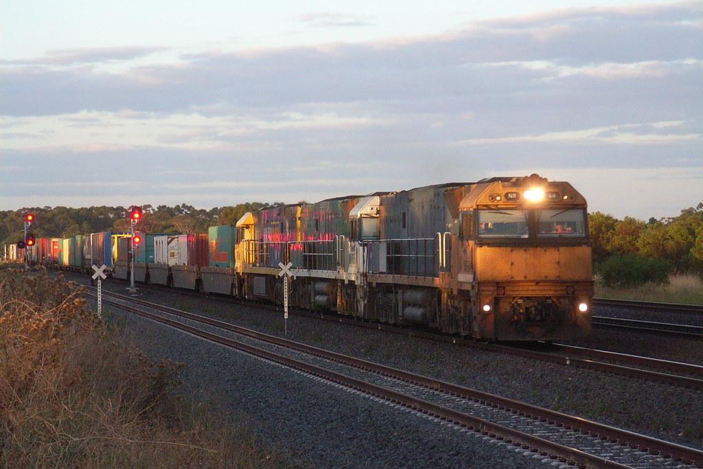 NR64 NR85 and NR81 on MA5 superfreighter service to Adelaide is powering through Elders Loop at Lara by bukk05