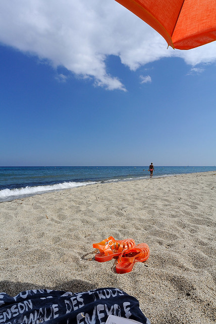Orange-shoes-on-the-sand