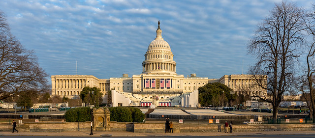 Washington DC, USA - January 15th 2017 -The West of the US Capitol Building prepared for the 58th presidential inauguration ceremony. The platform has been created and four of the flags are hung.
