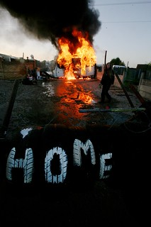 Eviction - Caravan on fire | by The Advocacy Project
