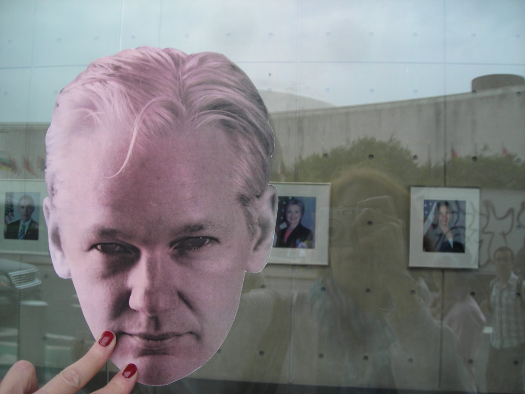 Julian Assange Outside & Hillary Clinton Inside State Dept UN