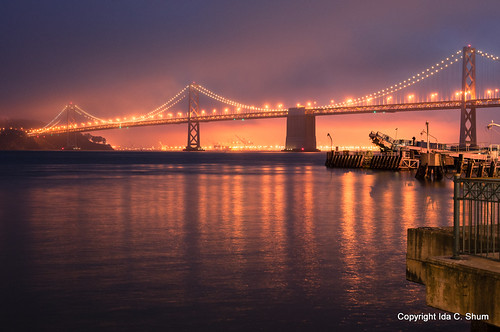 sanfrancisco city longexposure nightphotography bridge sunset water fog night reflections landscape lights oakland bay nikon cityscape shine treasureisland embarcadero bayarea sanfranciscobay glimmer ida shum portofoakland citybythebay foglights reflectionoflight idashum idacshum