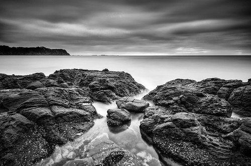 longexposure sea newzealand sky blackandwhite bw seascape beach water monochrome rock clouds bay coast nikon rocks surf waterfront filter lee nd northisland coromandel hahei hotwaterbeach nd110 mercurybay skanchelli