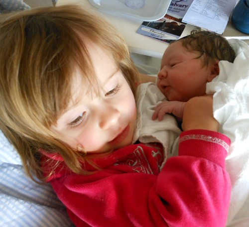 Cuddling Her New Sister   by mikecogh