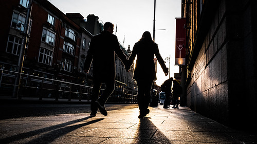 street city ireland light sunset sky urban dublin orange sun white yellow backlight contrast geotagged photography photo couple europe fuji shadows candid streetphotography faceless fujifilm ie onsale x70 fujix fujix70