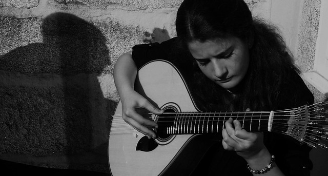the girl who loves to play portuguese guitar (L)