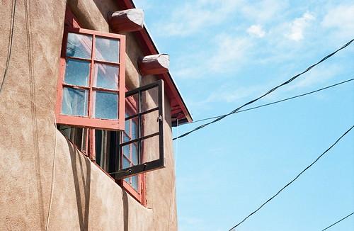 windows newmexico santafe southwest film architecture kodak rangefinder bluesky olympus openwindow powerlines adobe 35mmfilm canyonroad portra400vc americansouthwest olympusrangefinder 400vc 35sp uppercanyonroad