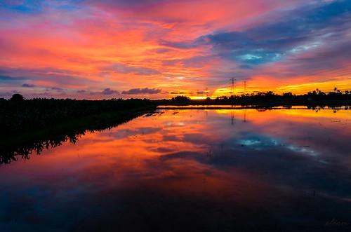 sunset reflection landscape fire malaysia melaka malacca paddyfield pulaugadong